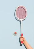 Woman's hand holding a retro badminton racket - 189753046