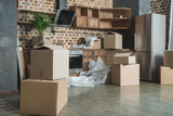cardboard boxes in empty kitchen during relocation - 189757476