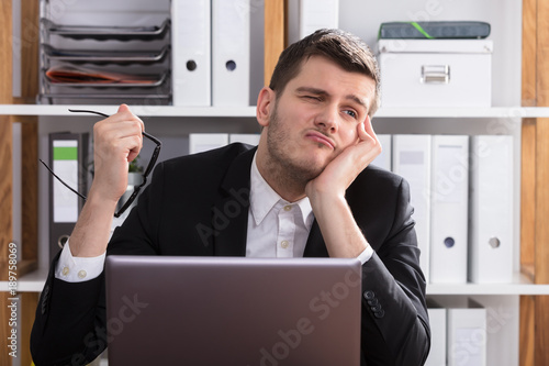 Contemplated Businessman Sitting In Office
