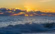 Sunrise Over Crashing Waves