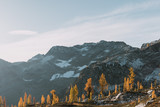 sunrise over mountains, lakes and larch trees