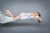 Sleeping girl. Flying in a dream. - 189798056
