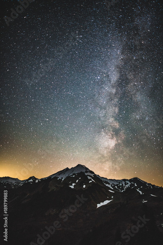 Fotobehang Zwart mountain and milky way in the night sky