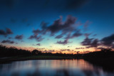 Beautiful sunset over the lake near the golf course in a tropical resort, Punta Cana - 189825477
