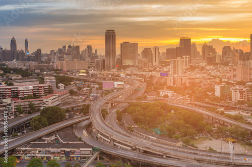 Fotobehang Shanghai Highway intersection with office building city downtown with sunset sky background, Bangkok Thailand