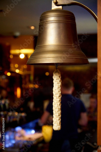 Fotobehang Schip Sea bell with a woven rope close-up on a blurred background
