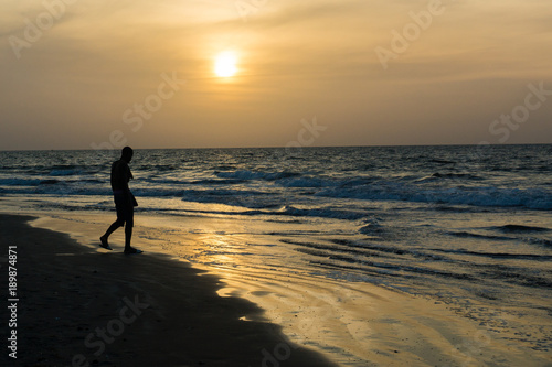 A man silhoutted on Kotu Beach, Gambia