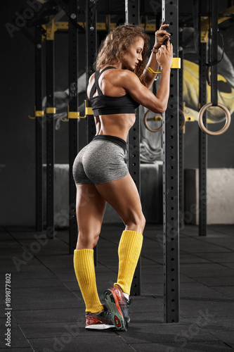 Sexy fitness woman in gym. Sporty muscular girl, workout