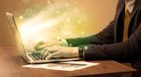 Businessman working fast on laptop - 189884492