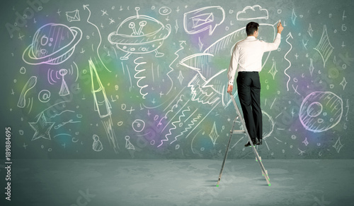 Fotobehang UFO Young businessman drawing rocket