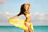 Sexy Asian bikini body model free on beach relaxing with slim legs and toned stomach in yellow swimwear and scarf - cellulite laser treatment , weight loss, wellness concept. - 189907461