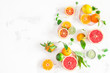 Quadro Fruit background. Colorful fresh fruits on white table. Orange, tangerine, lime, lemon, grapefruit. Flat lay, top view, copy space