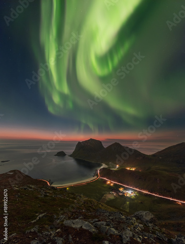 Fotobehang Noorderlicht Vertical panoramic photo of Aurora Borealis (the Northern Lights) taken at Norwegian Lofoten shortly after the sunet.