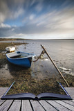 Creative book image of Beautiful vibrant sunset landscape image of boats moored in Fleet Lagoon in Dorset England - 189930607