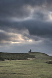 Stunning landscape image of Belle Tout lighthouse on South Downs National Park during stormy sky - 189931212