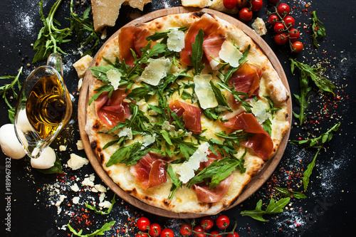 Aluminium Pizzeria Salmon and arugula pizza. Light and tasty restaurant meal for a foodie