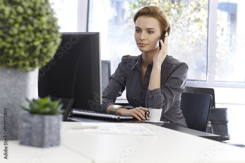 Businesswoman in green office