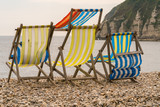 Empty Deck chairs on the pebble beach in Beer, Devon, UK - looking at Seaton Bay and the British channel - 189977461