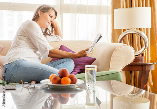 Woman on the couch with a magazine