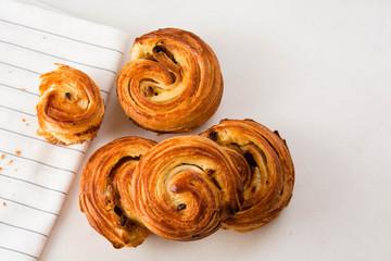 French traditional pastries. Croissant. Pains aux raisins.