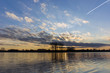 Clouds at sunset on the lake - 189983804