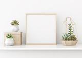 Fototapety Home interior poster mock up with horizontal gold metal frame and succulents on white wall background. 3D rendering.