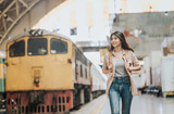 Happy beautiful traveler Asian woman with backpack walking at train station. - 189989423