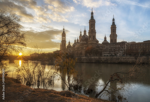 Cathedral-Basilica of Our Lady of the Pillar in Zaragoza and the Ebro River at the dawn, Spain.
