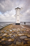 Windmill lighthouse in Swinoujscie on a cloudy day, Poland. - 189994882
