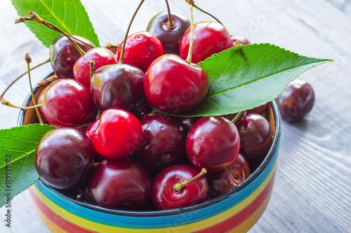 Fotobehang Kersen Cherry berries on a wooden background. Close-up. Selective focus.