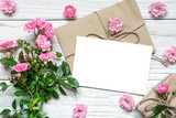 pink rose flowers bouquet with blank greeting card and gift box