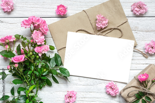 Fototapeta pink rose flowers bouquet with blank greeting card and gift box