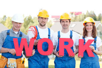 Workmen with word work outdoors