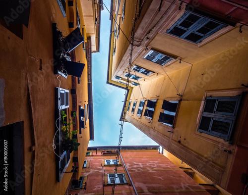 Fotobehang Smalle straatjes Camogli, Italy, narrow buildings