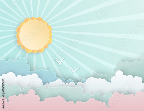 Fototapeta Colorful paper cut fluffy clouds and sun with rays in the blue sky. Flying birds. Modern 3d paper art style. Vector illustration of cloudscape, sunny day in pastel colors