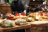 wooden tray of cheese tapas - 190016045