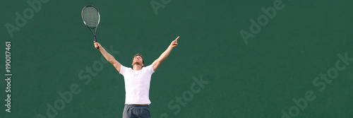 Fotobehang Tennis Tennis player man winning cheering celebrating victory in match point. Winner male athlete happy with arms up to the sky in celebration of success and win. Panoramic banner.