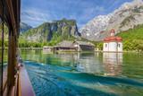 Fototapety Traditional passenger boat on Königssee lake with famous St. Bartholomä pilgrimage chapel in summer, Bavaria, Germany