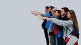 group of young people pointing at something. - 190024059