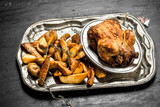 Fried chicken with potatoes on a tray. - 190038048