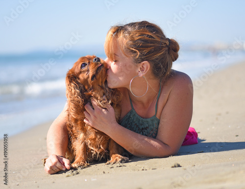 woman and dog on the beach Poster