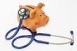 piggy bank and stethoscope - 190060831