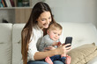 Mother and baby playing with a smart phone - 190064814