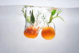 mandarins in water with a splash and air bubbles