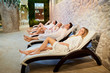 canvas print picture - People in bathrobes are resting in the spa salon. Friends relax on weekends.