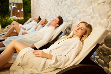 People in bathrobes are resting in the spa salon. Friends relax on weekends. © Studio Romantic