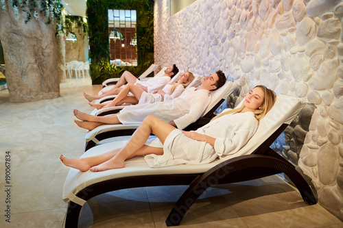 canvas print picture People in bathrobes are resting in the spa salon. Friends relax on weekends.
