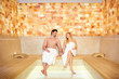 Quadro Couple in towels resting in the sauna. Man and woman in a spa salon.