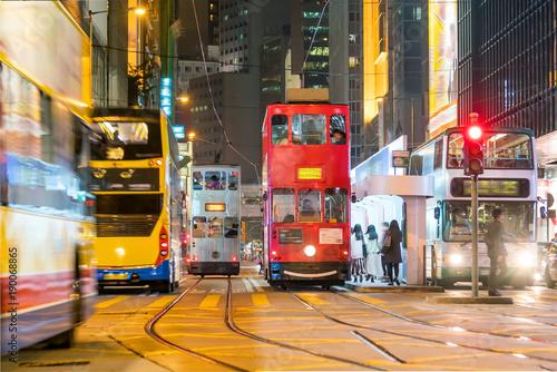fototapeta na ścianę Traditional tramways cars in downtown Central, Hong Kong
