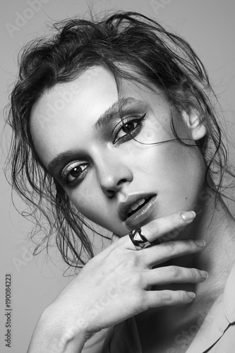 Beauty portrait of woman with perfect makeup. Black and white